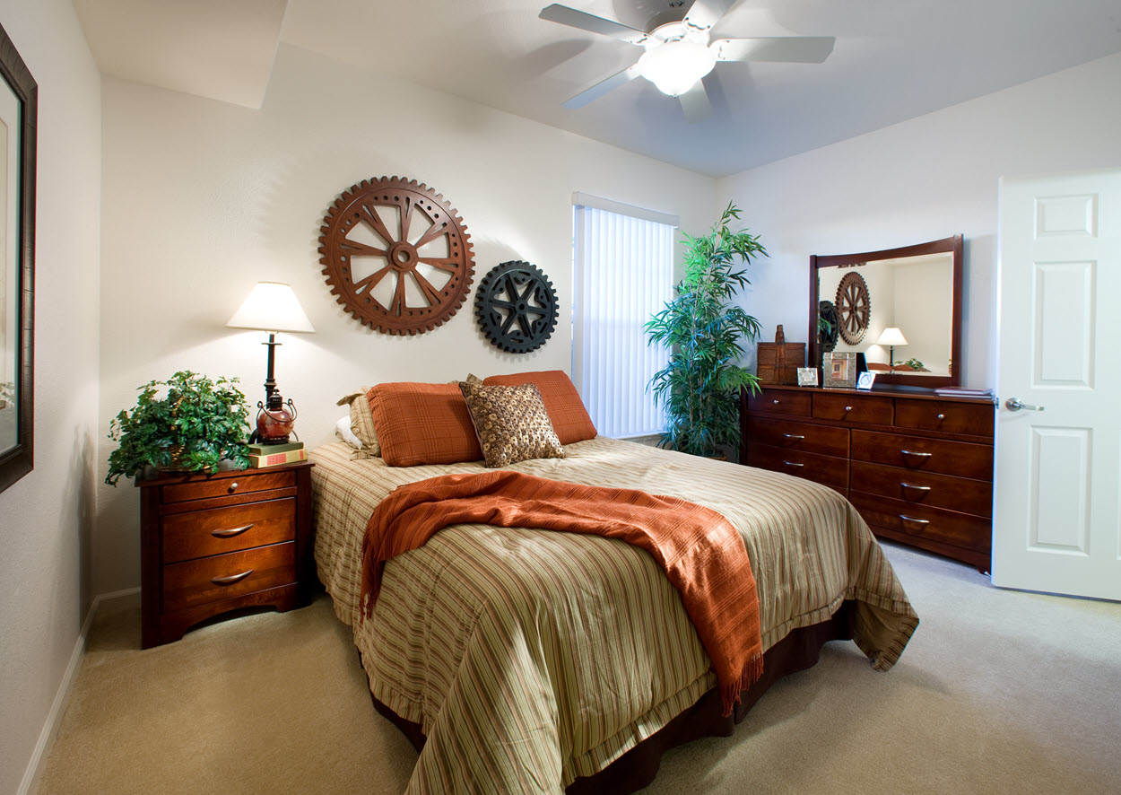 Bedroom at Vintage Square at Westpark with bed, nightstand, and dresser